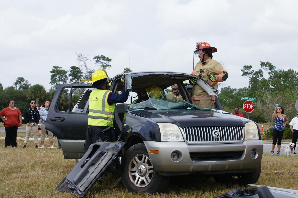Firefighters began cutting the roof during extrication demonstration