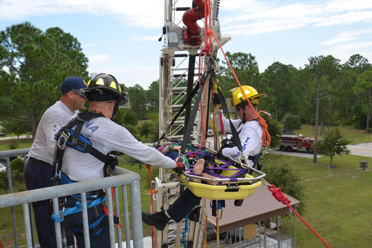 Firefighters practice rescuing manikin from a balcony during Special Operations Training
