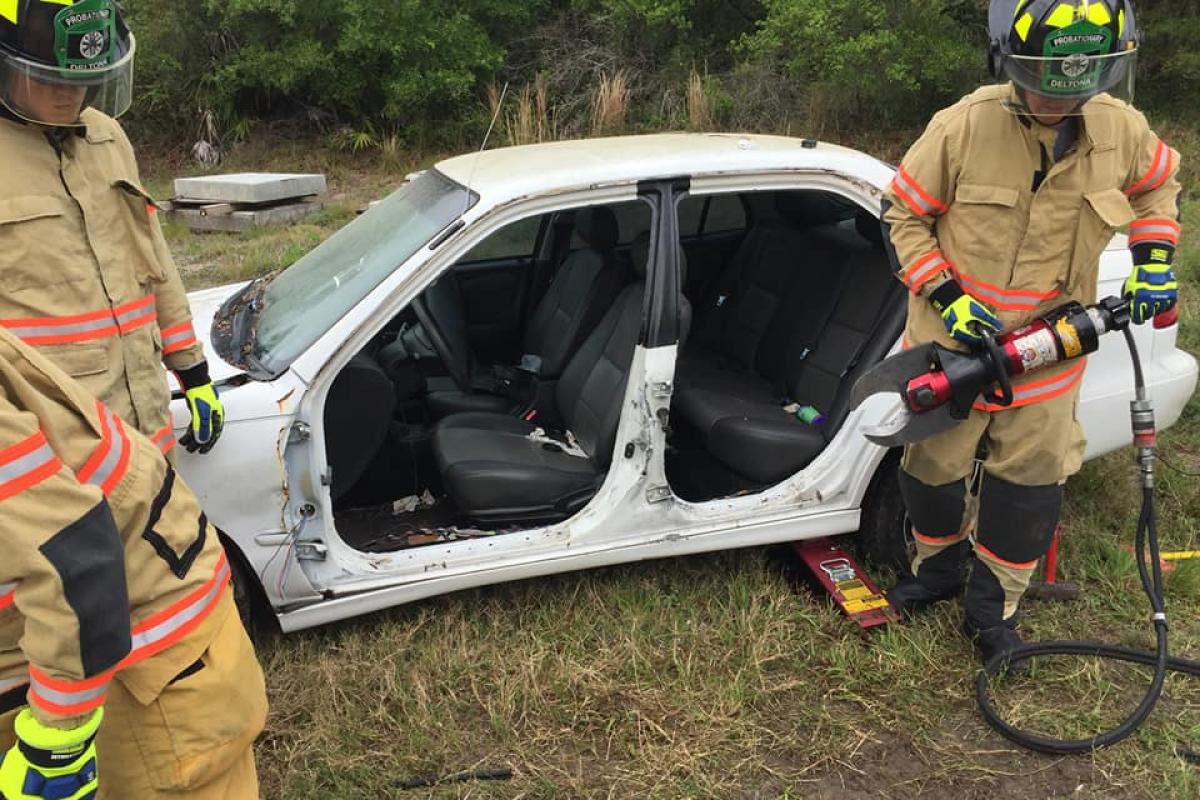 Firefighters with car during extrication training