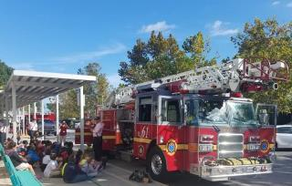 Firefighters talking to school students
